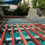 Over pool floor support beams